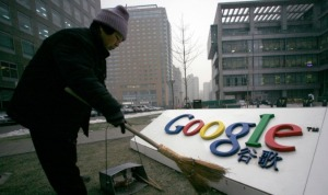 A cleaner sweeps the logo of Google China outside its company headquarters in Beijing, January 19, 2010. (Alfred Jin/Reuters)